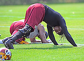 Washington Redskins quarterback Robert Griffin III (10) participates in stretching drills during the 2013 minicamp at Redskins Park in Ashburn, Virginia on Wednesday, June 12, 2013.<br /> Credit: Ron Sachs / CNP