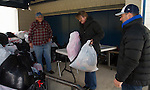 WOODBURY, CT - 22 OCTOBER 2016 - 102216JW01.jpg -- Surrounded by a wall of bags of donated clothing almost chest high clothing drive volunteers Chuck Wingard and Erika Hale take two more donated by Daren Altieri of Woodbury Saturday afternoon at Nonnewaug High Schoool. Proceeds of the drive go to benefit Gradnite which provides a celebration filled with entertainment, music, food, games and various activities for high school senior graduates the night of graduation.   Jonathan Wilcox Republican-American