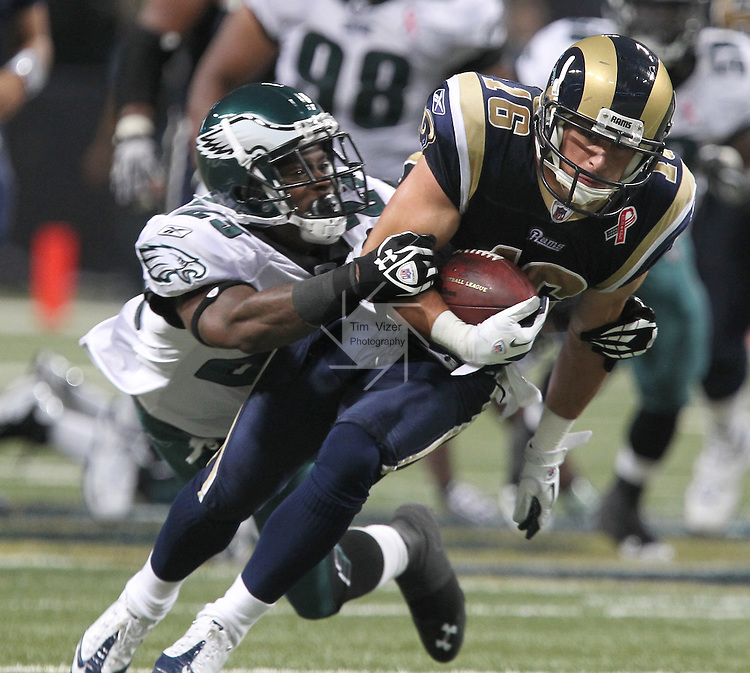091111tvhangingon.Eagles CB Dominique Rodgers-Cromartie (23, left) brings down Rams WR Danny Amendola (16) in the second quarter after Amendola caught an 18 yard pass from Rams QB Sam Bradford at the 11:39 mark.   .BND/TIM VIZER