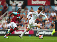Ki Sung-yueng of Swansea and Victor Moses of West Ham United   during the Barclays Premier League match between West Ham United and Swansea City  played at Boleyn Ground , London on 7th May 2016