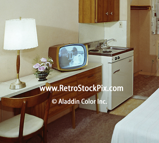motel room with very old black white tv show playing. Black Bedroom Furniture Sets. Home Design Ideas