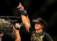 Oct. 29, 2011; Las Vegas, NV, USA; UFC fighter Donald Cerrone celebrates after winning a lightweight bout during UFC 137 at the Mandalay Bay event center. Mandatory Credit: Mark J. Rebilas-