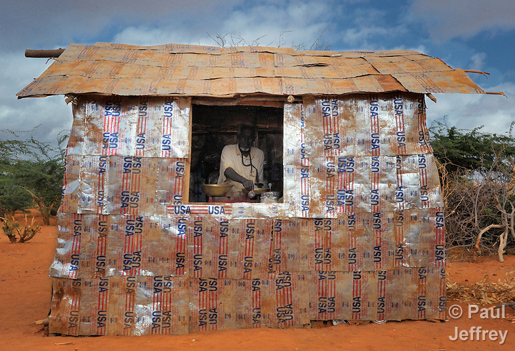 This man built his little store from recycled cooking oil cans in the Dadaab refugee camp in northeastern Kenya. He is among tens of thousands of newly arrived Somalis who have swelled the population of what was already the world's largest refugee camp.