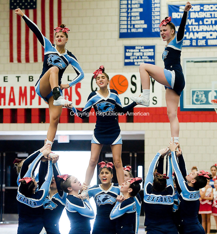 WATERBURY CT--- -022016JS12- The Oxford High School cheerleading team finishes their routine during the NVL Cheerleading Championships held Saturday at Crosby High School in Waterbury. Oxford would go on to be crowned NVL Champions. <br />   Jim Shannon Republican-American