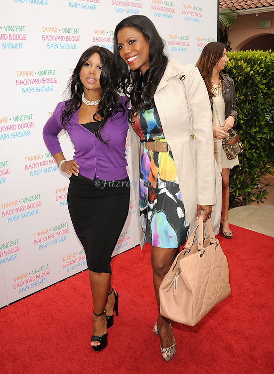 May 5, 2013   Beverly Hills, Ca..Toni Braxton and Omarosa Manigault.Tamar Braxton celebrates her Carnival Themed Baby Shower with friends and family, at the Hotel Bel Air..© Fitzroy Barrett / AFF-USA.COM