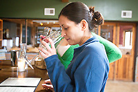 1/2/2011-  Lesley Trujillo smells a wine made by Todd Bostock, of Dos Cabezas Wineworks, in Sonoita, Arizona. (Photo by Pat Shannahan)