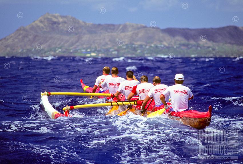 Outrigger canoe racing; Outrigger Canoe Club Men's crew, Men's Lanikai Race; offshore Kahala, Oahu - 1990.