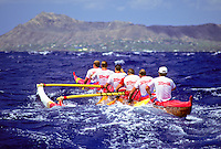 Outrigger canoe racing; Outrigger Canoe Club Men's crew, Men's Lanikai Race; offshore Kahala, Oahu - 1990.