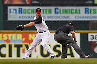 Rochester Red Wings second baseman Brian Dinkelman #12 attempts to tag out a runner during a game against the Scranton Wilkes-Barre Yankees at Frontier Field on August 21, 2011 in Rochester, New York.  The game was called due to thunderstorms in the second inning.  (Mike Janes/Four Seam Images)