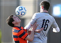 WASHINGTON, DC - NOVEMBER 25, 2012: Jimmy Nealis (16) of Georgetown University goes for a high ball with Ryan Tessler (18) of Syracuse University during an NCAA championship third round match at North Kehoe field, in Georgetown, Washington DC on November 25. Georgetown won 2-1 after overtime and penalty kicks.