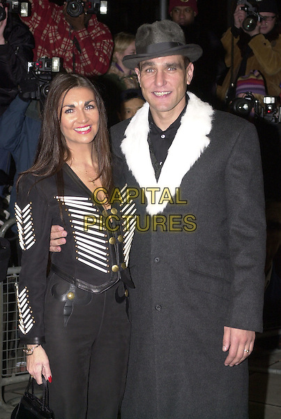 "VINNIE JONES & WIFE TANYA .Arrivals at film premiere of ""Mean Machine"", London, .18th December 2001..half length hat white fur trimmed collar coat.Ref: HT.www.capitalpictures.com.sales@capitalpictures.com.©Capital Pictures."