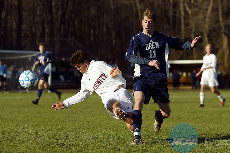 30 NOV 2003:  Tyler Brisk (11) of Drew University and Kelly Altman (12) of Trinity University battle for the ball during the Division III Mens Soccer Championship held at Ranger Field on the Drew University campus in Madison, NJ.  Trinity defeated Drew 2-1 for the national title.  Shannon Stapleton/NCAA Photos