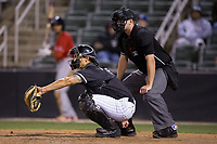 Kannapolis Intimidators catcher Seby Zavala (21) catches a pitch as home plate umpire Mike Rains looks on during the game against the Lakewood BlueClaws at Kannapolis Intimidators Stadium on April 6, 2017 in Kannapolis, North Carolina.  The BlueClaws defeated the Intimidators 7-5.  (Brian Westerholt/Four Seam Images)