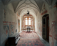 The careful restoration of the vaulted corridor has left many of the ancient frescos intact
