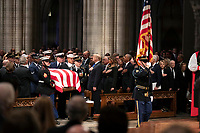 The flag-draped casket of former President George H.W. Bush is carried by a military honor guard past former President George W. Bush, left side, President Donald Trump, first lady Melania Trump, former President Barack Obama, Michelle Obama, former President Bill Clinton, former Secretary of State Hillary Clinton, former President Jimmy Carter, and Rosalynn Carter during a State Funeral at the National Cathedral, Wednesday, Dec. 5, 2018, in Washington.<br /> CAP/MPI/RS<br /> &copy;RS/MPI/Capital Pictures
