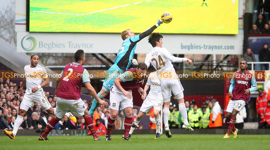 Gerhard Tremmel of Swansea punches clear - West Ham United vs Swansea City, Barclays Premier League at Upton Park, West Ham - 02/02/13 - MANDATORY CREDIT: Rob Newell/TGSPHOTO - Self billing applies where appropriate - 0845 094 6026 - contact@tgsphoto.co.uk - NO UNPAID USE.