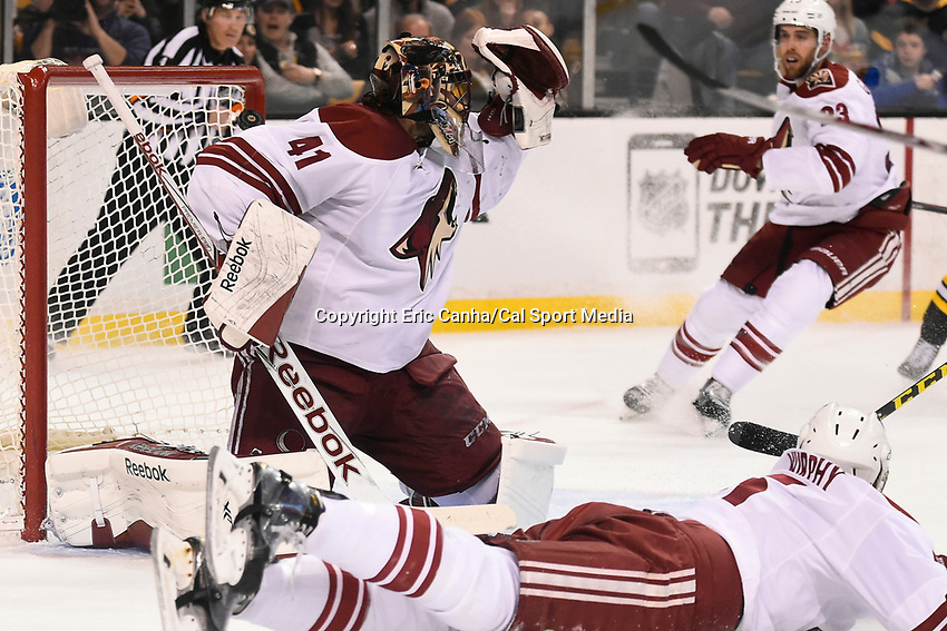 February 28, 2015 - Boston, Massachusetts, U.S. - Arizona Coyotes goalie Mike Smith (41) has the puck slip over his left shoulder duing the first period of the NHL match between the Arizona Coyotes and the Boston Bruins held at TD Garden in Boston Massachusetts. Eric Canha/CSM
