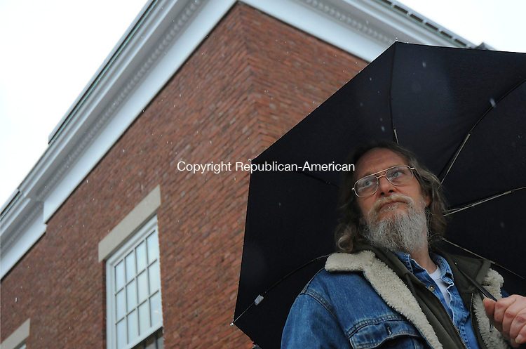 THOMASTON, CT-29 MARCH 2010-032910IP02-Gerald Barbetti of Thomaston waits in the rain for a ride home on Main St. in Thomaston on Monday. Barbetti said, &quot;Rain is nice except when you have to walk home in it&quot;. The rainy weather is expected to continue Tuesday.<br /> Irena Pastorello Republican-American