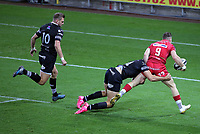 Gareth Davies of the Scarlets (R) is stopped by Bradley Davies of the Ospreys  during the Guinness PRO14 Round 6 match between Ospreys and Scarlets at The Liberty Stadium , Swansea, Wales, UK. Saturday 07 October 2017