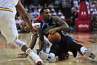 Hoyas' D'Vauntes Smith-Rivera tries to shield the ball from a defender. RMaryland defeated Georgetown 75-71 during a game at Xfinity Center in College Park, MD on Wednesday, November 17, 2015.  Alan P. Santos/DC Sports Box