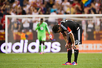 Chris Pontius (13) of DC United reacts to the loss at the end of the match. The New York Red Bulls defeated DC United 3-2 during a Major League Soccer (MLS) match at Red Bull Arena in Harrison, NJ, on June 24, 2012.