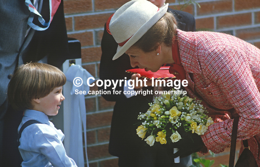 Princess Anne on a May 1985 visit to N Ireland is pictured at the official opening of an extension to Belfast Royal Academy's Preparatory Department at its Ben Madigan campus. She is seen talking to 5 year old Sarah Cole who has just presented her with a posy of flowers. 19850501a..Copyright Image from Victor Patterson, 54 Dorchester Park, Belfast, UK, BT9 6RJ..Tel: +44 28 9066 1296.Mob: +44 7802 353836.Voicemail +44 20 8816 7153.Skype: victorpattersonbelfast.Email: victorpatterson@me.com.Email: victorpatterson@ireland.com (back-up)..IMPORTANT: If you wish to use this image or any other of my images please go to www.victorpatterson.com and click on the Terms & Conditions. Then contact me by email or phone with the reference number(s) of the image(s) concerned.