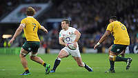 George Ford of England  passes as Michael Hooper and Sekope Kepu of Australia cover him during the Old Mutual Wealth Series match between England and Australia at Twickenham Stadium on Saturday 3rd December 2016 (Photo by Rob Munro)
