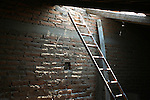 SHAFT of SOFT LIGHT ILLUMINATES LADDER BELOW GROUND