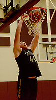 Graham Thomas/Siloam Sunday<br /> Siloam Springs junior post Jackson Ford dunks a basketball during practice inside the Panther Den on Thursday, July 25 at Siloam Springs High School.