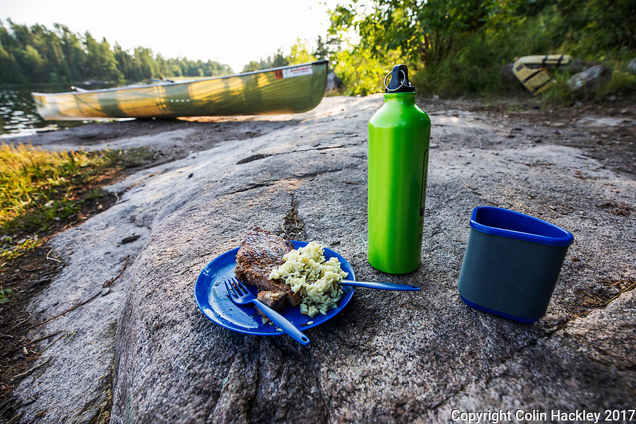 BWCA, MN, 7/27/17-Steak and wild rice for dinner at a campsite on Iron Lake's Three Island in the Boundary Waters Canoe Area.<br /> <br /> <br /> COLIN HACKLEY PHOTO