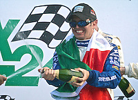 30 January 2011:Memo Rojas celebrates with champagne,  Rolex 24 at Daytona, Daytona International Speedway, Daytona Beach, FL (Photo by Brian Cleary/www.bcpix.com)