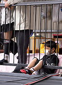 A boy in an exclusive booth watching the Tado Horse Festival.