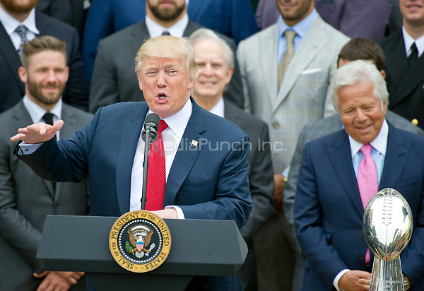 United States President Donald J. Trump makes remarks welcoming the Super Bowl Champion New England Patriots to the South Lawn of White House in Washington, DC on Wednesday, April 19, 2917.  Patriots owner Robert Kraft can be seen at right.<br /> Credit: Ron Sachs / CNP/MediaPunch<br /> <br /> (RESTRICTION: NO New York or New Jersey Newspapers or newspapers within a 75 mile radius of New York City)
