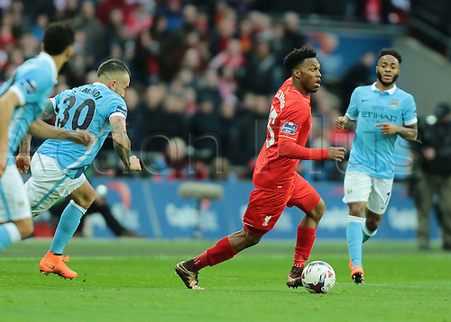 28.02.2016. Wembley Stadium, London, England. Capital One Cup Final. Manchester City versus Liverpool. Liverpool Forward Daniel Sturridge looks to cross the ball, as Manchester City Defender Nicolás Otamendi chases him