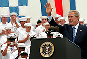 Coronado, Calif. (Aug. 30, 2005) - President George W. Bush waves to service members upon the completion of his speech on board Naval Air Station (NAS) North Island, Calif. President Bush visited NAS North Island to commemorate the 60th anniversary of the allied forces victory over Japan (VJ Day) during World War II. <br /> Mandatory Credit: Aaron Burden / US Navy via CNP