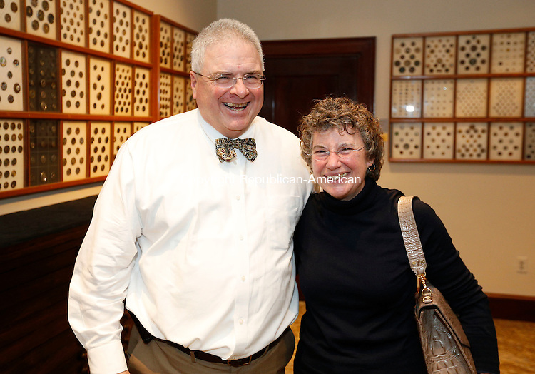 Waterbury, CT- 22 January 2016-012216CM14-  Social Moments, from left to right, Joseph Migani and his wife, Joan O'Riordan of Seymour, are photographed during the Mattatuck Museum's opening celebration for it's new exhibitions in Waterbury on Friday.   Christopher Massa Republican-American