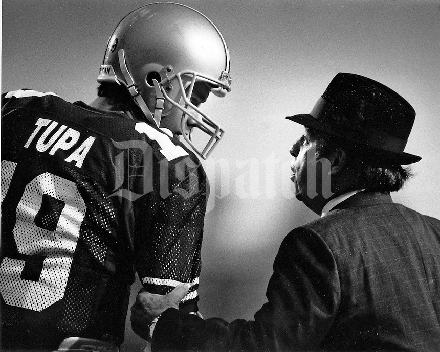 Ohio State coach Earle Bruce (right) talking to Tom Tupa , third quarter  Nov. 4, 1987 (Columbus Dispatch Photo by Tim Revell)