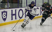 Worcester, Massachusetts - January 5, 2019: NCAA Division I. University of Connecticut (UCONN) (blue) College of the Holy Cross (white), 6-3, at Hart Center at the Luth Athletic Complex.