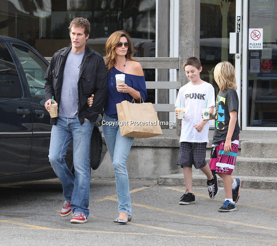 "1-15-2010.Exclusive ...Cindy Crawford leaving Star Bucks coffee in Malibu California with her husband Rande Gerber & and kids Presley & Kaia.  As Cindy was walking to her car the photographer told Cindy how pretty she looked & her husband quickly said, ""hey what about me?"" the photographer quickly replied, ""Oh you look super handsome on this lovely day"" Cindy erupted in laughter.  ...AbilityFilms@yahoo.com.805-427-3519.www.AbilityFilms.com"