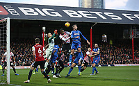 Bolton Wanderers' Christian Doidge and Brentford's Ezri Konsa challenge a corner<br /> <br /> Photographer Rob Newell/CameraSport<br /> <br /> The EFL Sky Bet Championship - Brentford v Bolton Wanderers - Saturday 22nd December 2018 - Griffin Park - Brentford<br /> <br /> World Copyright © 2018 CameraSport. All rights reserved. 43 Linden Ave. Countesthorpe. Leicester. England. LE8 5PG - Tel: +44 (0) 116 277 4147 - admin@camerasport.com - www.camerasport.com