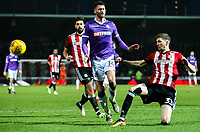 Bolton Wanderers' Gary Madine is tackled by Brentford's Chris Mepham<br /> <br /> Photographer Alex Dodd/CameraSport<br /> <br /> The EFL Sky Bet Championship - Brentford v Bolton Wanderers - Saturday 13th January 2018 - Griffin Park - Brentford<br /> <br /> World Copyright &copy; 2018 CameraSport. All rights reserved. 43 Linden Ave. Countesthorpe. Leicester. England. LE8 5PG - Tel: +44 (0) 116 277 4147 - admin@camerasport.com - www.camerasport.com