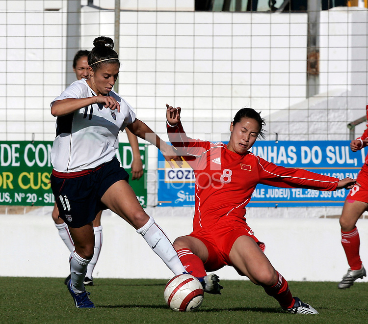 Carli Lloyd (L) battles Zhang Tong (R) during a Algarve Women´s Cup soccer match between USA and China at the Silves Stadium in Silves, Portugal, March 7, 2007.