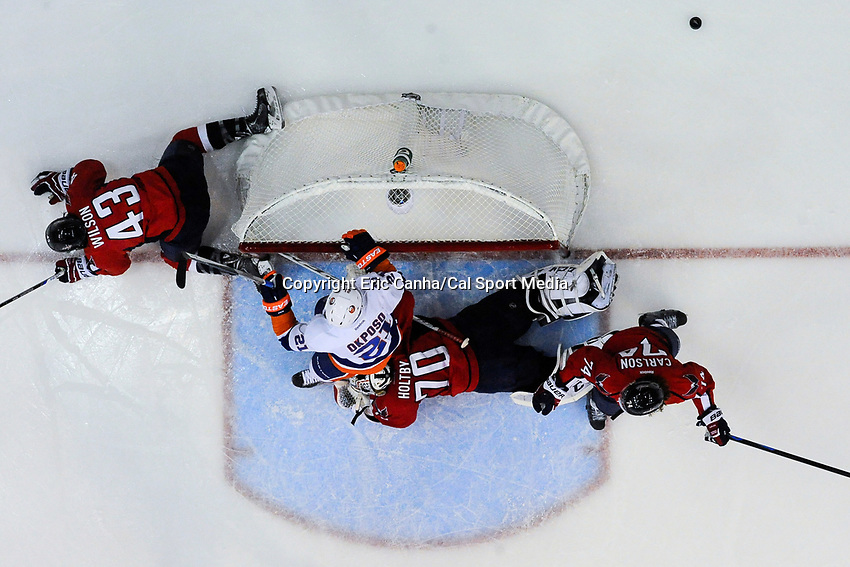 April 23, 2015 - Washington D.C., U.S. - New York Islanders right wing Kyle Okposo (21) and Washington Capitals goalie Braden Holtby (70) collide in front of the net during game 5 of the  NHL Eastern Conference Quarter finals between the New York Islanders and the Washington Capitals held at the Verizon Center in Washington DC.  The Capitals defeat the Islanders 5-1 in regulation time to take the lead in the 7 game series 3-2. Eric Canha/CSM