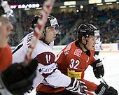 Roberts Bukarts (Latvia - 11), Ramon Untersander (Switzerland - 32) - Team Switzerland defeated Team Latvia 7-5 on Wednesday, December 30, 2009, at the Credit Union Centre in Saskatoon, Saskatchewan, during the 2010 World Juniors tournament.