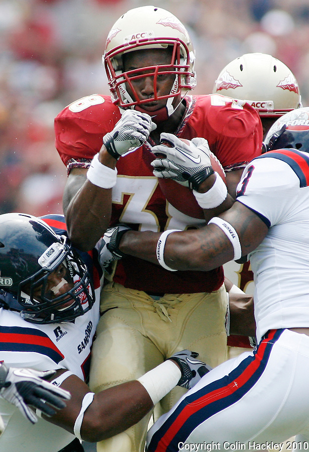TALLAHASSEE, FL 9/4/10-FSU-SAMFORD FB10 CH-Florida State's Jermaine Thomas is mobbed by Samford defenders during first quarter action Saturday at Doak Campbell Stadium in Tallahassee. The Seminoles beat the Bulldogs 59-6 to give Head Coach Jimbo Fisher his first victory..COLIN HACKLEY PHOTO