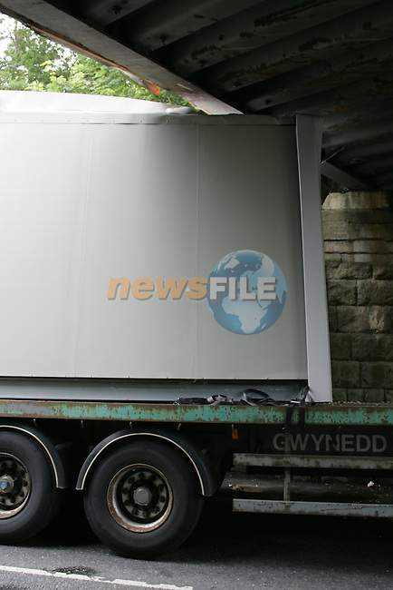 One school left without a classroom as the Lorry carrying the portacabin hit the railway bridge in Drogheda early on Friday morning causing traffic delays in the Town..Photo: Fran Caffrey/ Newsfile.