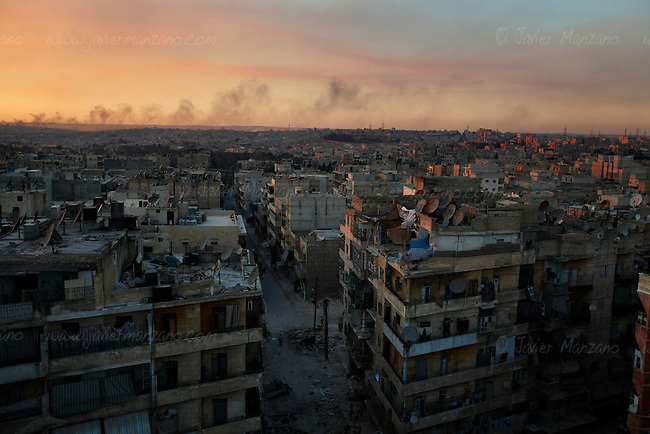 Smoke rises over Aleppo after targets in opposition-controlled areas of the city were struck by aerial bombardments.