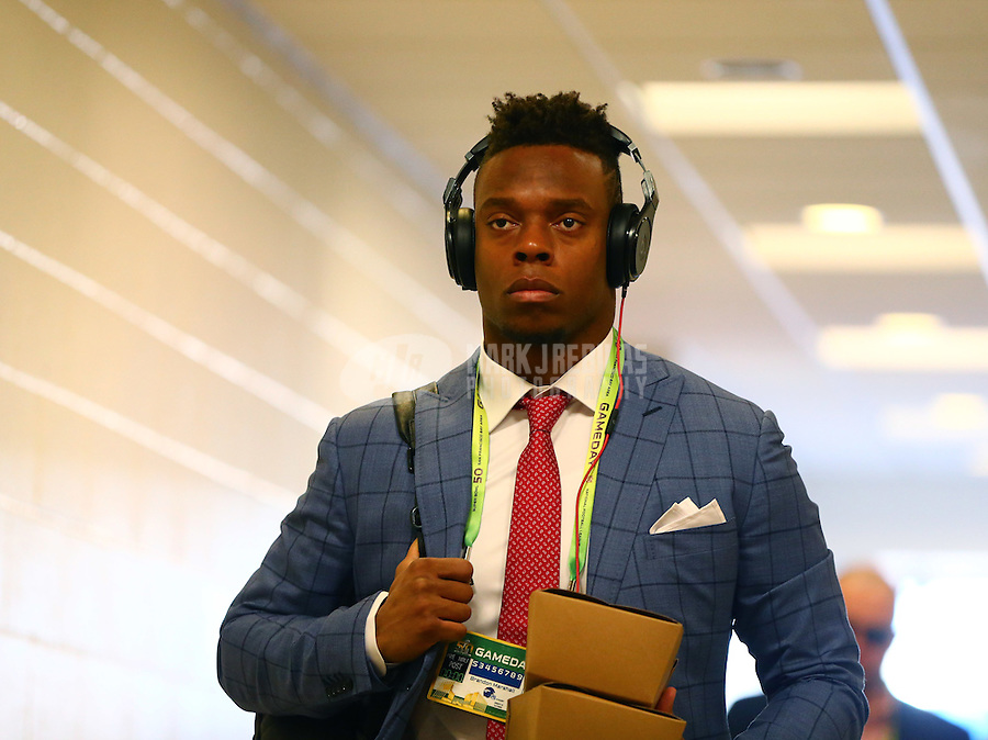 Feb 7, 2016; Santa Clara, CA, USA; Denver Broncos linebacker Brandon Marshall arrives to the stadium wearing a suit and tie and wearing Beats by Dre headphones prior to the game against the Carolina Panthers in Super Bowl 50 at Levi's Stadium. Mandatory Credit: Mark J. Rebilas-USA TODAY Sports