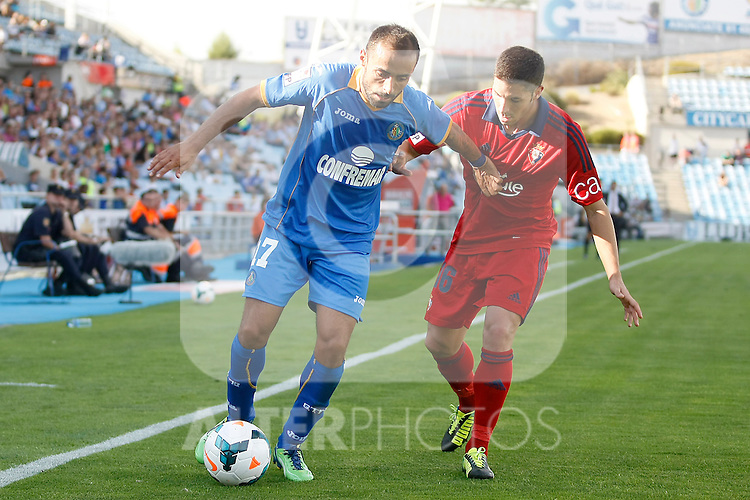 Getafe's  Diego Castro (l) and Osasuna's Alvaro Cejudo during La Liga match.September 15,2013. (ALTERPHOTOS/Acero)