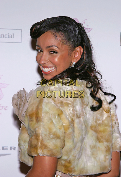 MYA.The Lili Claire Foundation's 7th Annual Benefit Gala .16 November 2004.headshot, portrait, fur coat, looking over shoulder.www.capitalpictures.com.sales@capitalpictures.com.© Capital Pictures.